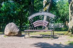 Bench of Chelmno - city of lovers at park in Wejherowo. Wejherowo, Poland - August 2, 2018: Bench of Chelmno - city of lovers at park in Wejherowo Stock Images