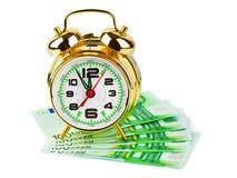 Wekker en geld Stock Foto