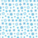 Błękitni płatki śniegu na bielu Fotografia Stock