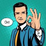 Wektorowa ilustracja pomyślny biznesmen daje ok w rocznika wystrzału sztuki komiczek stylu Podobieństwa i pozytywny odczucie gest Fotografia Royalty Free