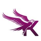 Wektorowe purpury Stawiają czoło jastrzębia K Początkowego loga obrazy royalty free