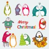 Wektorowi boże narodzenia pocztówkowi z ślicznymi pingwinami ilustracja wektor