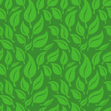 Wektorowy bezszwowy tło z zielonymi liśćmi Obrazy Stock