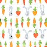 Wektorowy bezszwowy wzór z kreskówek marchewkami i królikami Fotografia Stock