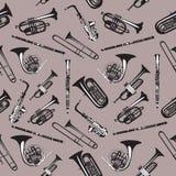 Wektorowy bezszwowy wzór z wiatrowymi instrumentami muzycznymi royalty ilustracja