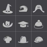 Wektorowy czarny hełm i kapeluszowe ikony ustawiający ilustracja wektor