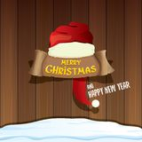 Wektorowy czerwony Santa kapelusz z papierowymi tekstów Wesoło bożymi narodzeniami i Szczęśliwym nowym rokiem na drewnianym tle s ilustracji