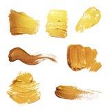 Wektorowy złocisty farba rozmazu uderzenia plamy set złota abstrakcyjna konsystencja ilustracja wektor