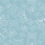 Wektorowych błękitnych motyli bezszwowy deseniowy tło ilustracji
