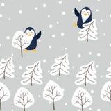 Wektoru wzór z śliczną kreskówka pingwinów sosną i śniegiem fotografia royalty free