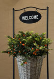 Welcome. Decoration with flowers holder Royalty Free Stock Photo