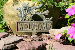 Welcome. Sign in front of home porch Stock Images