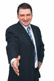 Welcome. Portrait of a mature business man with hand outstretched to welcome you over white background Royalty Free Stock Photos