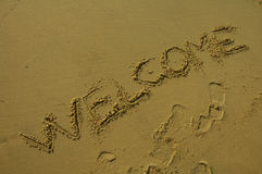 Welcome. Written in sand on a beach Stock Photography