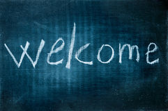Welcome. Written with a chalk on a blackboard Royalty Free Stock Photo