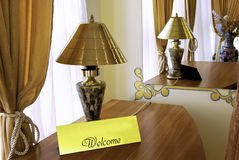 Welcome. Tag, tablet sign in a hotel room table Stock Image