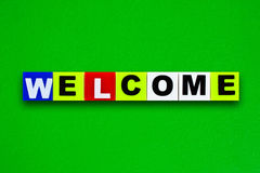 Welcome. Colorful plastic letters with welcome isolated on green background Royalty Free Stock Photo