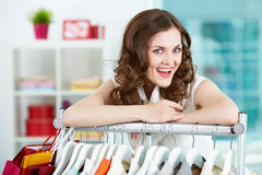 Welcome!. Portrait of happy woman looking at camera in clothing departmant Stock Photos