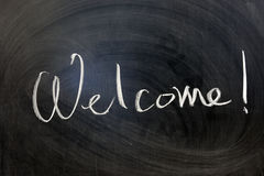 Welcome. Chalk writing - Welcome word written on chalkboard Royalty Free Stock Photo