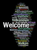 Welcome. A cloud of the word welcome greeting in different languages in black background, the more widely spoken translation in bigger fonts Royalty Free Stock Photography