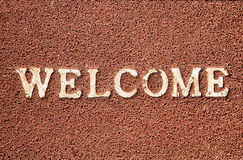 Welcome. Title on the doormat. Free space for your text Royalty Free Stock Images