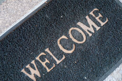 Welcome. Doormat deteriorated with the word welcome Stock Photography