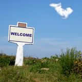 Welcome. Road Sign in the country with blue sky and a cloud Stock Photo