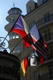 Welcome!. American, Czech, Israeli and German flags on a hotel in Karlovy Vary, Czech Republic Stock Photo
