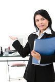 Welcome in. A businesswoman welcoming her guest to come in her office Royalty Free Stock Photos