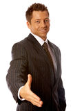 Welcome. Handsome Businessman with welcome hand gesture Royalty Free Stock Photos
