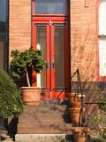 Welcome. Brightly painted red front door Stock Images