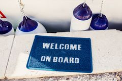 Welcome aboard mat on yacht Stock Photos
