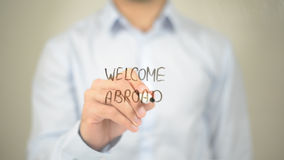 Welcome Abroad, Man Writing on Transparent Screen stock photos