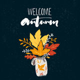 Welcome autumn banner with brush calligraphy and drawing of posy of the golden leaves. Vector fall design with Royalty Free Stock Photo