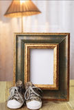 Welcome baby gift frame decorated. Welcome baby gift with shoes frame decorated Stock Photography