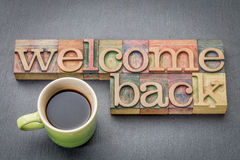 Welcome back sign in wood type. Welcome back sign - text in letterpress wood type with a cup of coffee stock images