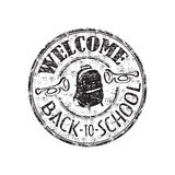 Welcome back to school. Black grunge rubber stamp with schoolbag and the text welcome back to school written inside the stamp Royalty Free Stock Photos