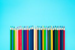 Welcome back to school background, colorful color pencil on blue backgrounds with copy space royalty free stock image
