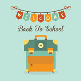 Welcome Back To School banner message with retro school bag icon. On blue background Royalty Free Stock Image
