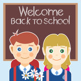 Welcome back to school card with a boy, a girl and flowers Royalty Free Stock Images