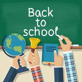 Welcome back to school. Concept education. Vector illustration flat design. Holding in hand globe, book, bell, chalk, on background of school board Royalty Free Stock Photo