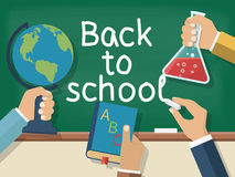 Welcome back to school. Concept education. Vector illustration flat design. Holding in hand globe, book, bell, chalk, on background of school board Stock Photography