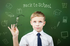 Welcome back to school!. Concept of first of september and beginning of learning for student and school child. There is a boy looking up and group of objects Stock Image
