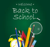 Welcome back to School design on green background with school supplies Royalty Free Stock Images