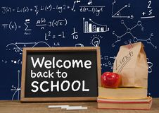 Welcome back to school Desk foreground with blackboard graphics of math equations Royalty Free Stock Image