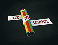 Welcome back to school embroidered on ribbon on colorful crayons Royalty Free Stock Image