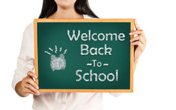 Welcome back to school on green board. Stock Images