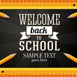 Welcome back to school greeting card with place. For your text, with pencils and rulers on chalkboard background Stock Photo