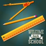 Welcome back to school greeting with ruler, pencil. And compass Royalty Free Stock Photo