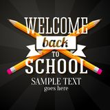 Welcome back to school greeting with two crossed. Pencils and place for your text Royalty Free Stock Photo